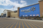 Wal-Mart issues warning of difficult time for profits and sales